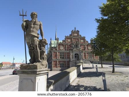 Statue of Neptune in front of former stockexchange in Copenhagen - stock photo