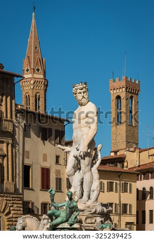 Statue of Neptune with towers in background, Piazza della Signoria, Florence (Italy) - stock photo