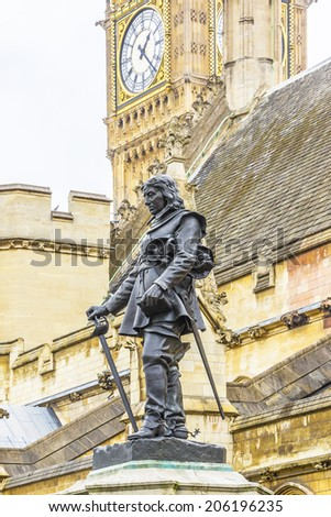 Statue of Oliver Cromwell in front of House of Commons of United Kingdom in Westminster (Parliament), London, UK. Statue was designed by Hamo Thornycroft and erected in 1899. - stock photo