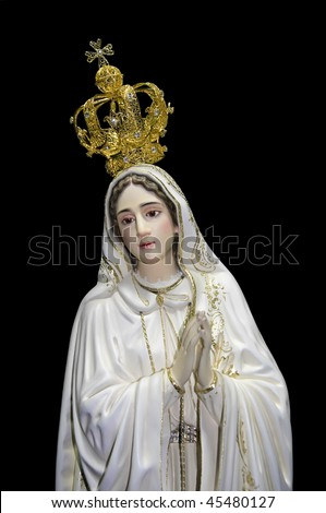 Statue of Our Lady of Fatima over black background - stock photo