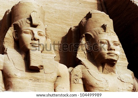 Statue of Pharaoh Ramesses II at the Great at the Great Temple of Abu Simbel on the border of Egypt and Sudan. - stock photo