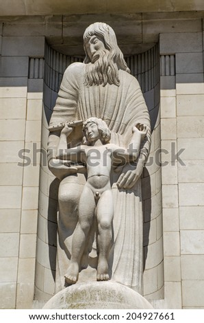 Statue of Prometheus and Ariel, characters from Shakespeare's Tempest, on the front of BBC Broadcasting House in Central London since 1933.  Viewed from public pavement. - stock photo