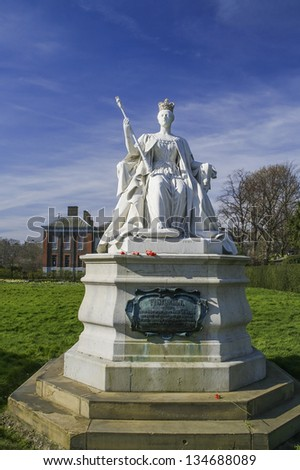 Statue of Queen Victoria in front of her Kensington palace - stock photo