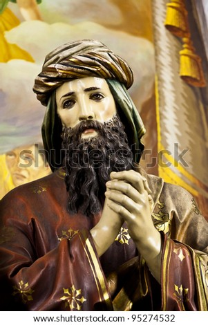 Statue of Saint Joseph praying for Jesus life, taken inside the public church of Sagrado Coração de Jesus, dated of 1885, in Sao Paulo, Brazil. - stock photo