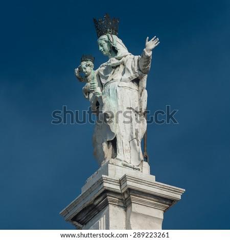 Statue of Saint Maria at Basilica di Santa Maria della Salute, Venice, Italy, summer 2015 - stock photo