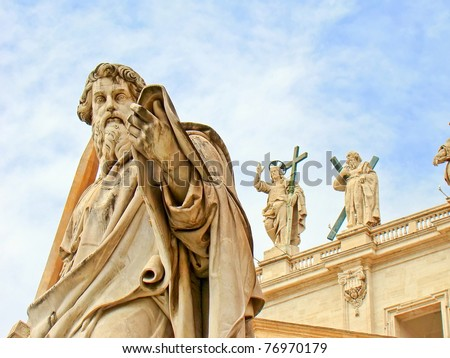 Statue of Saint Peter outside of the Papal Basilica of Saint Peter in Vatican City, Rome, Italy. On the background there's the statue of Jesus Christ, situated on the top of the basilica's facade. - stock photo