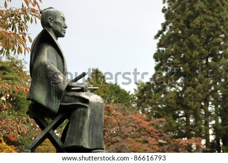 Statue of Samurai sitting and watching, Nikko National Park, Nikko, Japan - stock photo