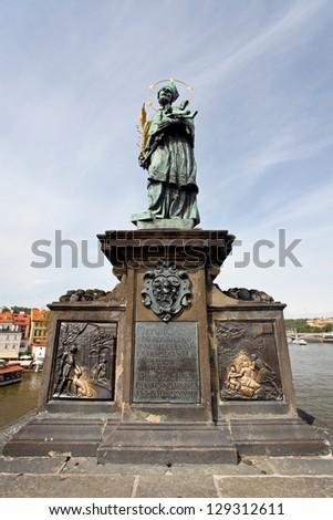 Statue of Sf. John of Nepomuk on the Charles bridge in Prague,Czech Republic - stock photo