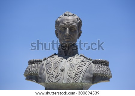 Statue of Simon Bolivar on public square in Merida against a clear blue sky. Venezuela - stock photo