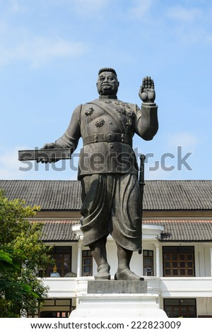 Statue of Sisavang Vong of the National museum complex of Luang Prabang, Laos. - stock photo