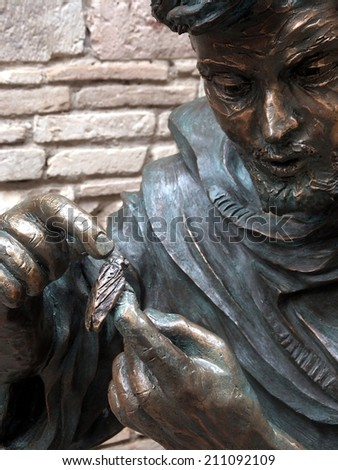 statue of St. Francis in the garden of the monastery in Assisi, Italy - stock photo