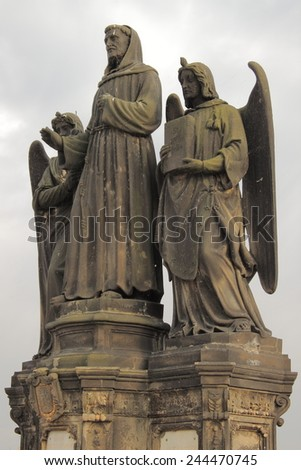 Statue of St. Francis Seraphic in Charles bridge, Prague - stock photo