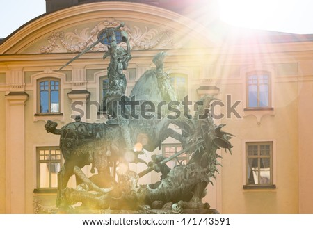 Statue of St. George and Dragon in old town of Stockholm Gamla Stan. Sun beaming in camera. Sweden, Scandinavia, Europe.