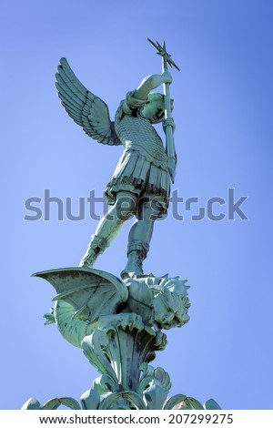 Statue of St George at top of Notre Dame de Fourviere in Lyon, France. - stock photo
