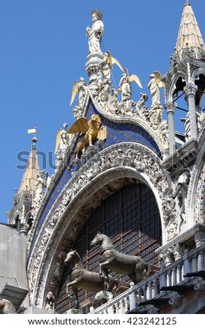 Statue of St. Mark with winged lion on the roof of St. Mark Cathedral in Venice, Italy - stock photo