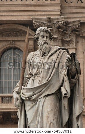 Statue of St. Paul holding a sword in St. Peter's Square at the Vatican - stock photo