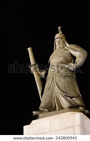 Statue of the Admiral Yi Sun-Sin, the Korean hero at Gwanghwamun Square in the night - stock photo