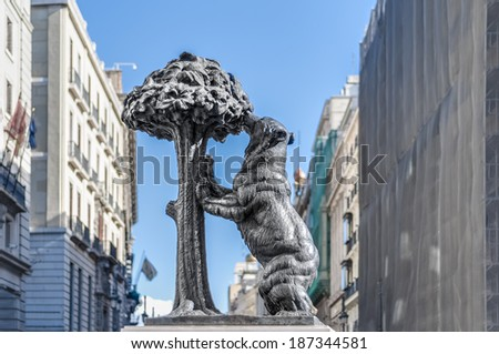 Statue of the Bear and the Strawberry Tree (Oso y el Madrono), sculpture which represents the heraldic arms of the city, installed on Puerta del Sol Square in Madrid, Spain. - stock photo
