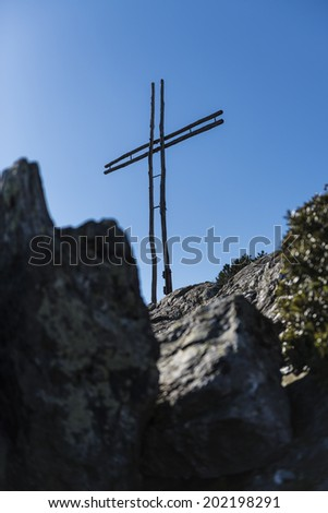 Statue of the crucifixion on a background of the sky. - stock photo