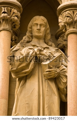 Statue of the former Bishop of Worcester Edward Stillingfleet (1635 - 1699).  Outside the chapel of St John's College, Cambridge.