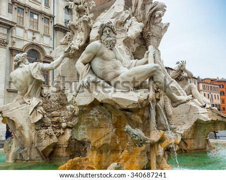 Statue of the god Zeus in Bernini's Fountain of the Four Rivers in Piazza Navona, Rome. Detail of the allegorical Ganges figure. - stock photo