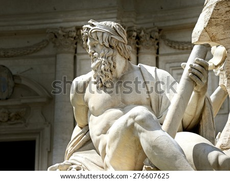 Statue of the god Zeus in Bernini's Fountain of the Four Rivers in the Piazza Navona, Rome - stock photo