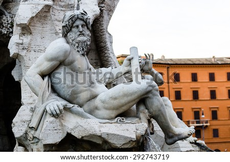 Statue of the god Zeus in Bernini's Fountain of the Four Rivers in the Piazza Navona, Rome - detail of the allegorical Ganges figure - stock photo
