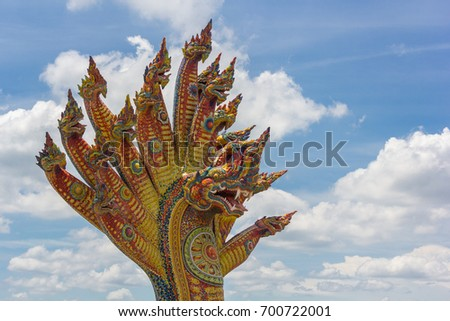 Statue of the 19 Headed Naga (Serpent) with blue sky in Wat Ban Rai (Ban Rai Temple), Khun Thot district, Nakhon Ratchasima province, Thailand - Aug 11, 2017