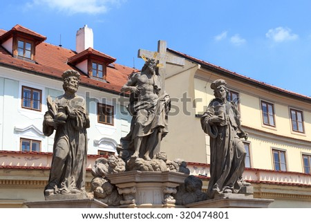 Statue of the Holy Savior with Cosmas and Damian at Charles Bridge, Prague - stock photo