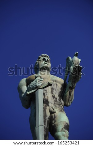 Statue of the Victor opposite blue sky. The Victor (in Serbian Pobednik) is a monument located in the Belgrade Fortress in Belgrade, built to commemorate Serbia's liberation from Ottoman occupation.  - stock photo