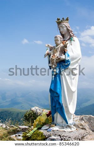statue of the Virgin Mary in in mountains of Pyrenees, France - stock photo