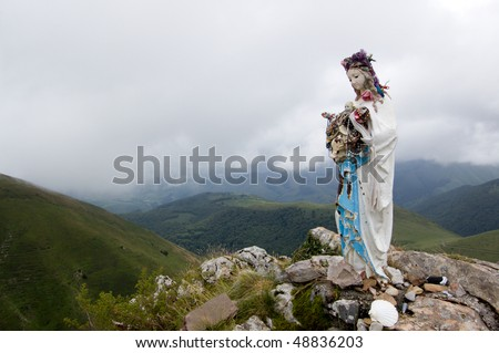 statue of the Virgin Mary in in mountains of Pyrenees, Spain - stock photo