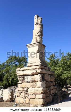 Statue of triton in the Odeion of Agrippa, Athens, Greece - stock photo