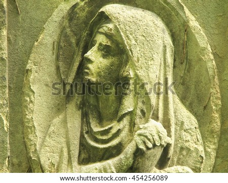 Statue of Virgin Mary as a symbol of love and kindness - stock photo