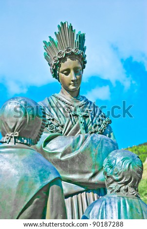 Statue of Virgin Mother and children in La Salette - stock photo