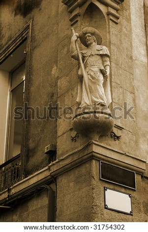 Statue on a building in Aix-en-provence, France. Sepia tone - stock photo