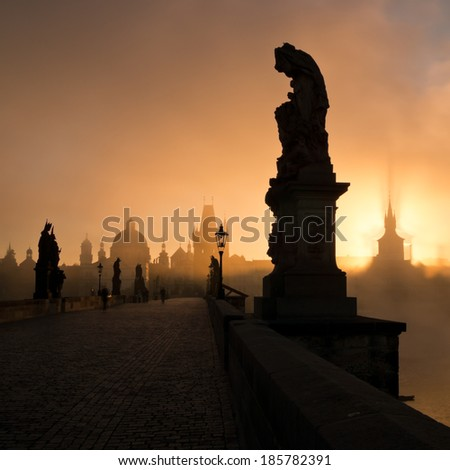 Statue on a Charles bridge in Prague on a foggy morning - stock photo