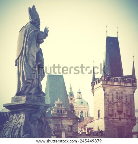 Statue on Charles bridge in Prague, Chech republic. Retro style filtred image - stock photo