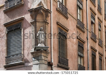 Statue on the building facade. House sign in Lyon, France - stock photo