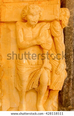 Statue on the Cathedral of St. Lawrence (Katedrala Sv. Lovre), a Roman Catholic triple-naved basilica constructed in Romanesque-Gothic in Trogir, Croatia. UNESCO World heritage - stock photo