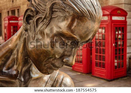 statue Prima Ballerina in Covent Garden against red phone boxes - stock photo