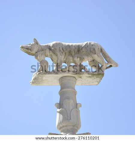 Statue representing a she-wolf suckling the twins Romulus and Remus, Piazza del Duomo, Siena, Tuscany, Italy - stock photo