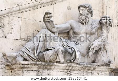 Statue representing the god of the river Nile placed in front of Palazzo Senatorio in Campidoglio (The Capitoline Hill). Rome, Italy. - stock photo