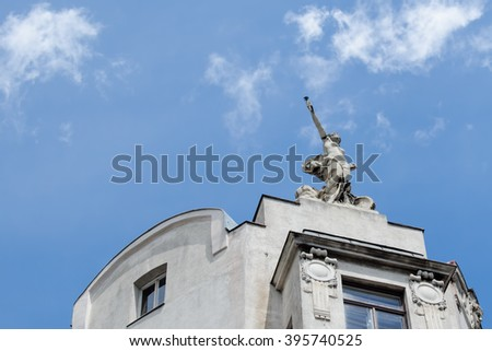 statue revealing victory on top of the building
