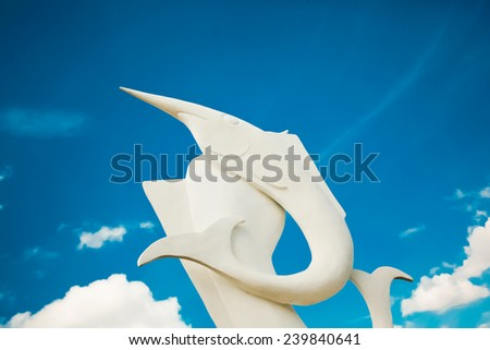 statue white fish and blue sky