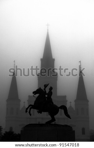 Statue with Church in background in New Orleans, Louisiana - stock photo