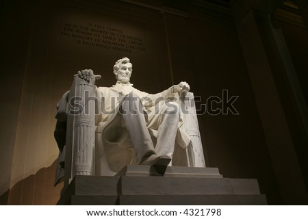 statue within the lincoln memorial at night - stock photo