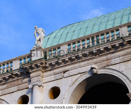 statues above the historical building called BASILICA PALLADIANA in Vicenza City Italy