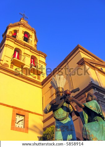 Statues and bell tower of the historic Convento de la Cruz (Convent of the Cross) in the colonial city of Queretaro, Mexico. - stock photo