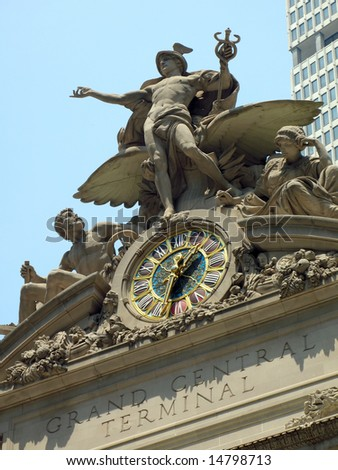 Statues and clock atop Grand Central Terminal in Midtown Manhattan in New York City. - stock photo